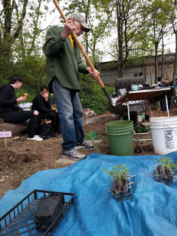 Mixing soil and compost